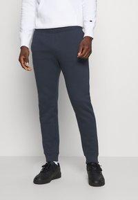 Champion - LEGACY CUFF PANTS - Teplákové kalhoty - dark blue - 0