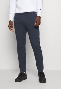 Champion - LEGACY CUFF PANTS - Tracksuit bottoms - dark blue - 0