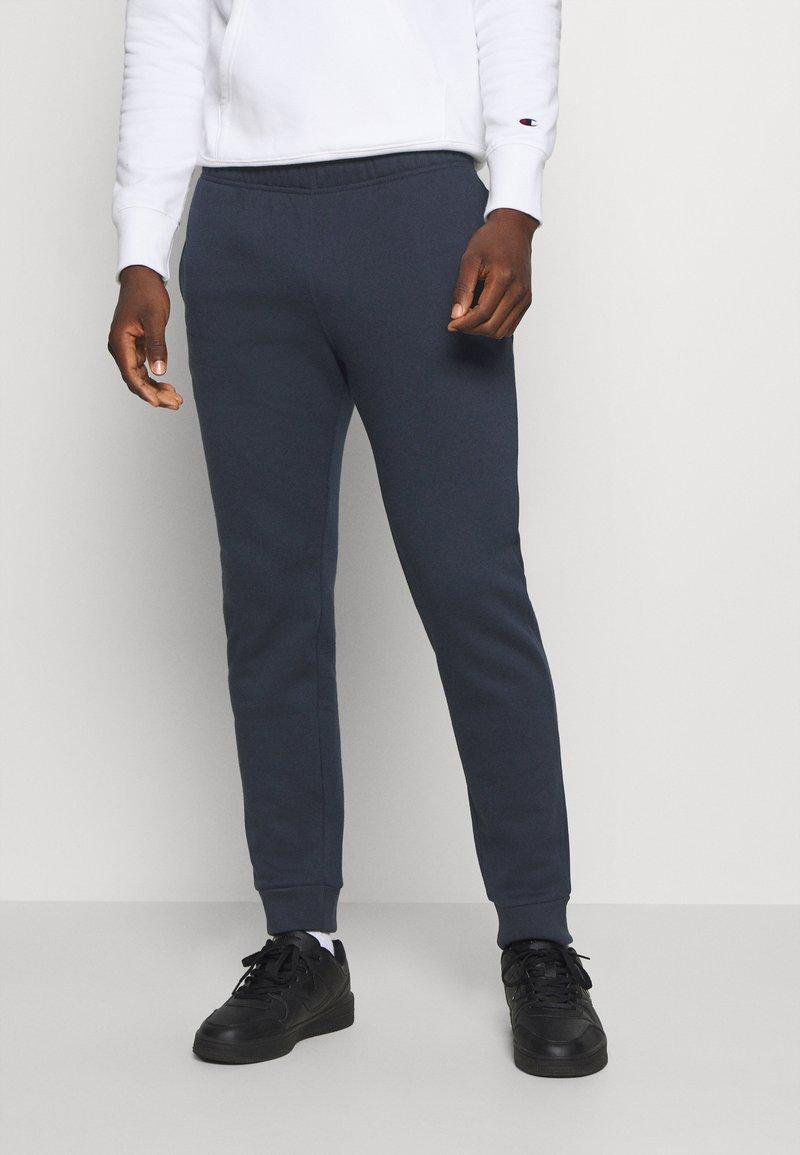 Champion - LEGACY CUFF PANTS - Tracksuit bottoms - dark blue