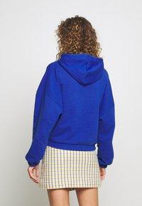 Hummel Hive - HMLVIG LOOSE HOODIE - Jersey con capucha - mazarine blue - 2
