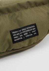 Nike Sportswear - HERITAGE HIP PACK - Bum bag - medium olive/white - 8