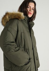 Urban Classics Curvy - LADIES OVERSIZE PUFFER COAT - Winter coat - darkolive/beige - 6