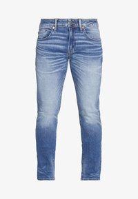 American Eagle - MEDIUM WASH TAPER - Jeans slim fit - medium bright indigo - 4