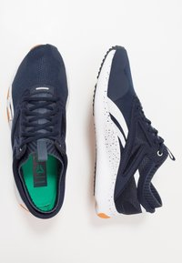 Reebok - HIIT TR - Sports shoes - navy/white - 1