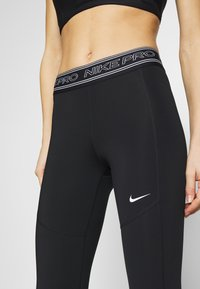 Nike Performance - TIGHT 7/8  - Leggings - black/white - 6