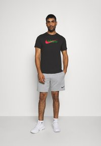 Nike Performance - TEE ATHLETE - T-shirt print - black - 1