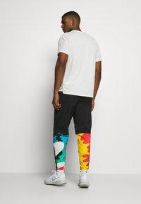 Nike Performance - PANT ART - Träningsbyxor - black - 2
