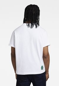 G-Star - FLOCK BOXY R T UNISEX  - Print T-shirt - dry jersey o white - 3