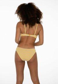 Protest - DOLORES  - Bikini - sun rays - 2