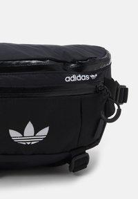 adidas Originals - WAISTBAG UNISEX - Bum bag - black/white - 3