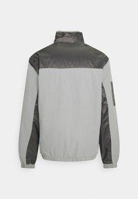 Karl Kani - SIGNATURE BLOCK - Training jacket - grey - 1