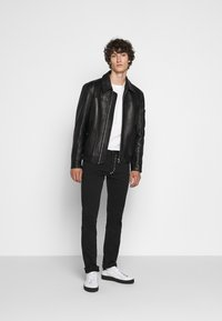 Just Cavalli - PANTALONE - Slim fit jeans - black - 1