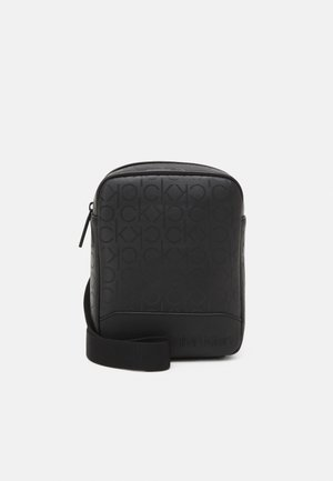 REPORTER UNISEX - Across body bag - black
