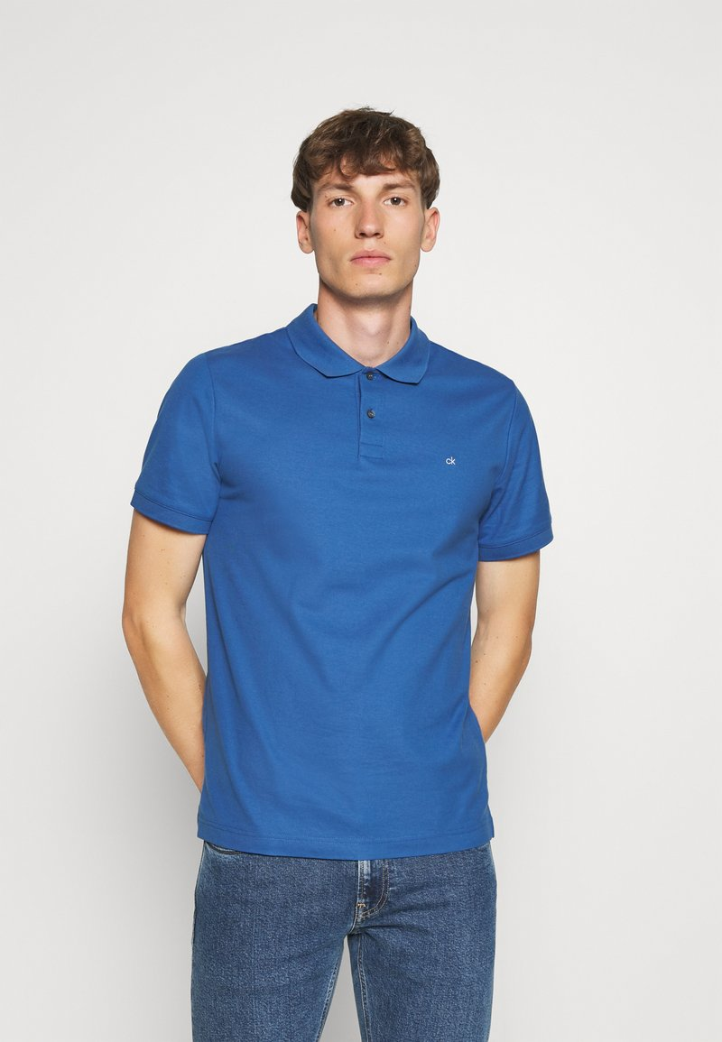 Calvin Klein - REFINED LOGO SLIM - Polo shirt - blue