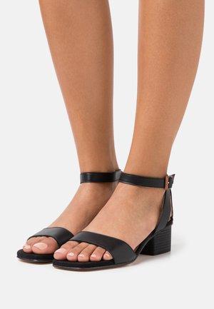 KRUCES - Sandals - black
