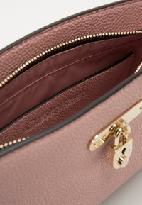 Calvin Klein - DRESSED BUSINESS CROSSBODY - Across body bag - purple - 4