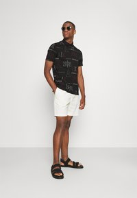 Armani Exchange - Polo shirt - black/red heritage - 1
