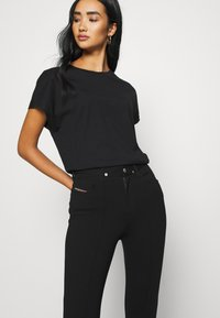Diesel - P-CUPERY TROUSERS - Trousers - black - 3