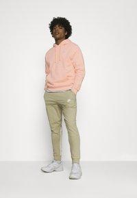 Nike Sportswear - CLUB HOODIE - Sweater - arctic orange - 1