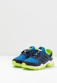 adidas Performance - TERREX HYDROTERRA - Hiking shoes - glow blue/core black/singnal green - 3
