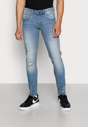 STOCKHOLM DESTROY - Jeans slim fit - arctic blue