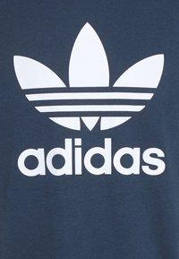 adidas Originals - BLOCKED TREF UNISEX - T-shirt con stampa - crew nacy/hazy green/ice yellow - 6