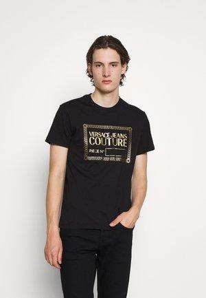 T-shirt con stampa - nero/oro