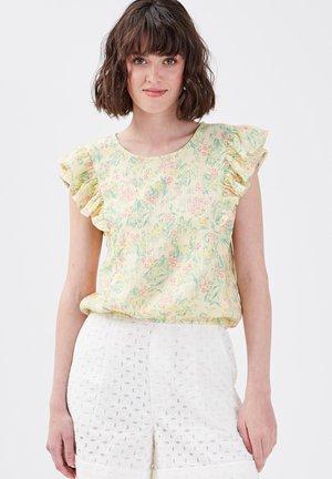 Camiseta estampada - jaune pastel