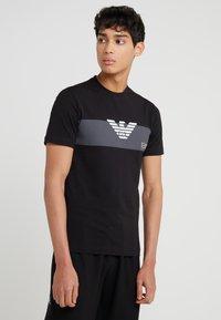 EA7 Emporio Armani - T-shirts print - black - 0