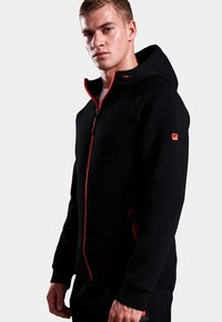 Superdry - GYM TECH STRETCH  - Training jacket - black - 0