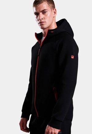 GYM TECH STRETCH  - Training jacket - black