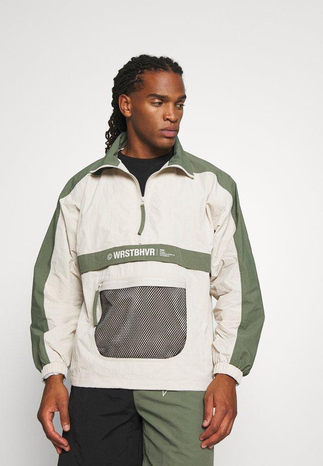 WINDBREAKER DUSK UNISEX - Training jacket - off white/green