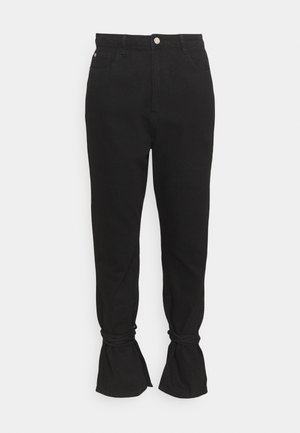 RIOT HIGHWAISTED TIE HEM MOM - Relaxed fit jeans - black