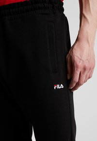 Fila - EDAN PANTS - Tracksuit bottoms - black - 4