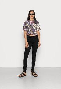Diesel - SLANDY - Jeans Skinny Fit - black denim - 1