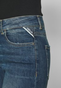 Replay - FAABY FLARE CROP PANTS - Slim fit jeans - medium blue - 3