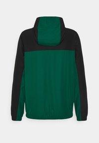 Lacoste Sport - TRACK JACKET - Training jacket - black/bottle green/white - 7