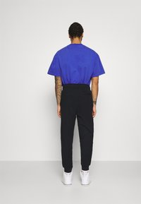 Jordan - PANT - Tracksuit bottoms - black/white - 2