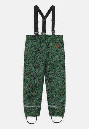 EDELWEISS UNISEX - Rain trousers - green