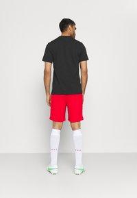 Nike Performance - FC TEE JOGA - T-shirt con stampa - black - 2