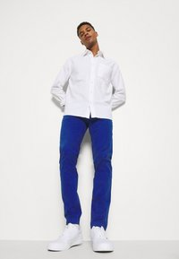 Tommy Jeans - SCANTON PANT - Trousers - blue - 3