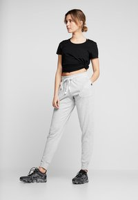 Cotton On Body - GYM TRACKPANT - Tracksuit bottoms - cloudy grey marle - 1