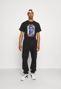 Grimey - HIGH PRIESTESS TEE UNISEX - T-shirt med print - black - 1