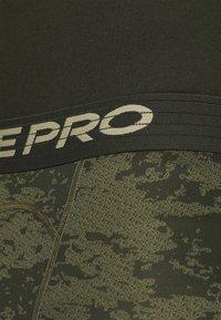 Nike Performance - Leggings - medium olive/white - 6