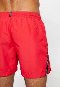 Calvin Klein Swimwear - MEDIUM DRAWSTRING - Badeshorts - lipstick red - 1