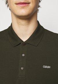 HUGO - DONOS - Polo shirt - dark green - 4