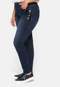 Sheego - Slim fit jeans - blue black denim - 3