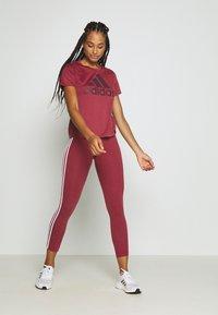 adidas Performance - LOGO TEE - Print T-shirt - legred/maroon - 1
