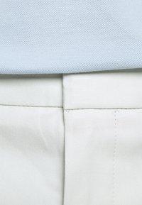 HUGO - HELDOR - Oblekové kalhoty - natural - 4