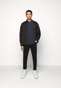 HUGO - DINOSO - Polo shirt - dark blue - 1